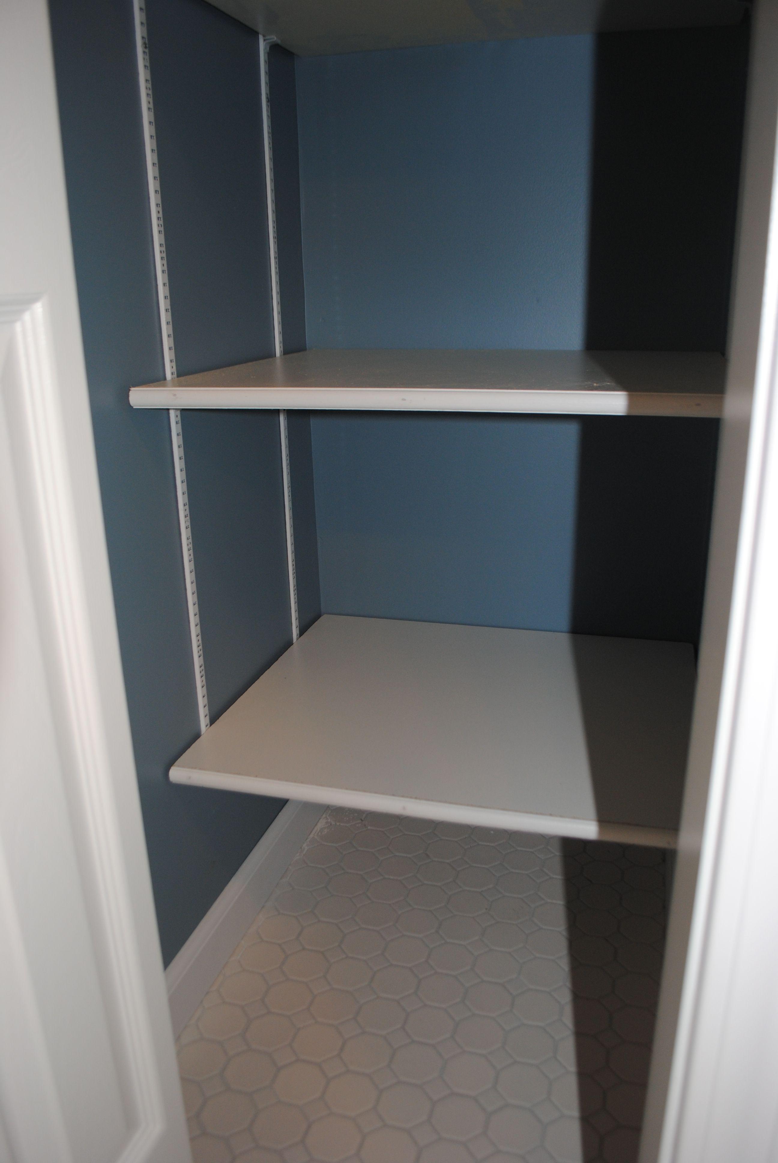 Adjustable melamine coated closet shelving in a bathroom