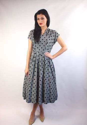"""This is a gorgeous 1950's polkadot grey/blue and black tea dress Made from taffeta material, with felt polkadots and the original metal zip fastening on the side.In good overall condition, however there are some storage marks on the upper back of the dress.SIZEBust - 38"""" Waist - 28"""" Hips - Free sizeLength from shoulder to hem, 48""""I would say this is a UK 10/12.Model is 5ft 10"""" and a size 10Any questions please contact us...."""