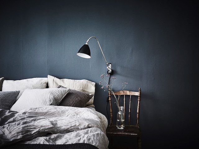 A lovely Swedish home with a blue accent wall in the bedroom