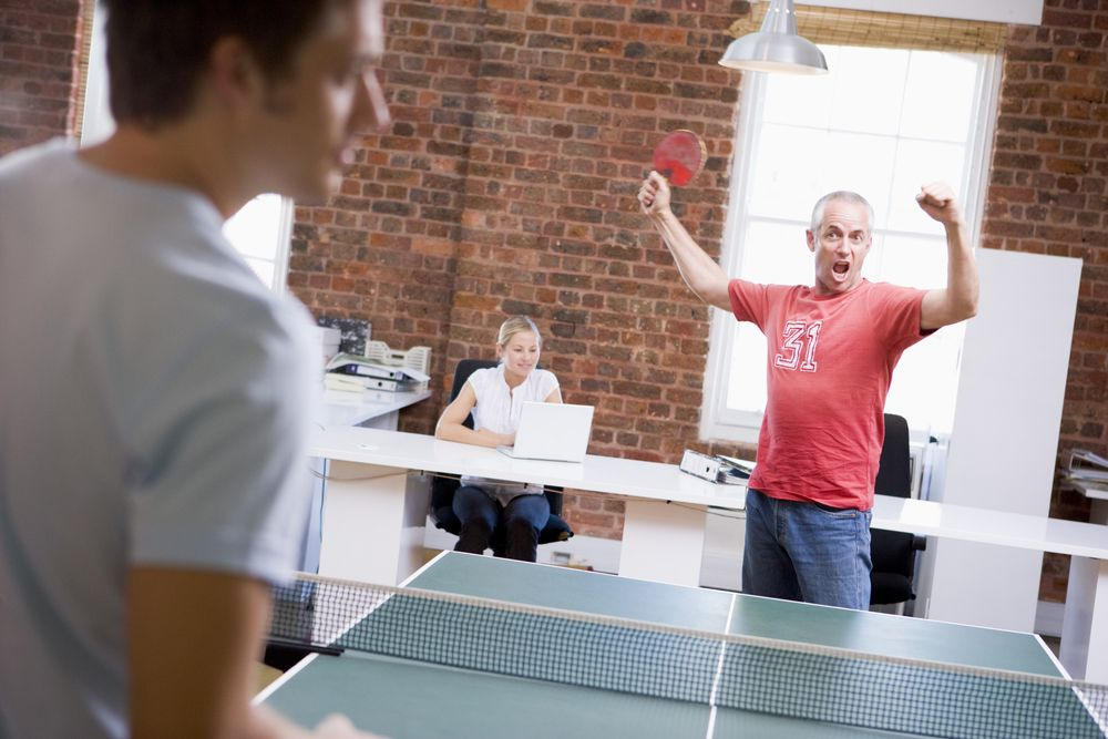 two men in office space playing ping pong table tennis sports rh pinterest com