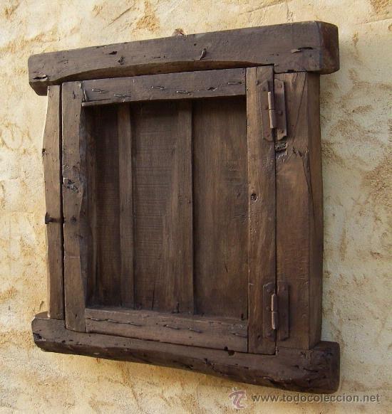 Ventana castellana de madera antigua con reja de hierro for Puertas rusticas de madera