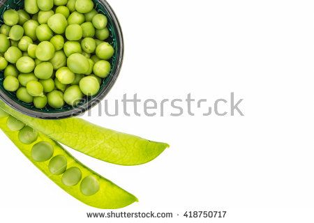 Fresh green peas in bowl, on white background with copy-space - stock photo