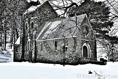 Ellingwood Chapel, a Gothic Revival structure built in 1920. Located in Nahant Massachusetts.Shownhereafterasnowstorm