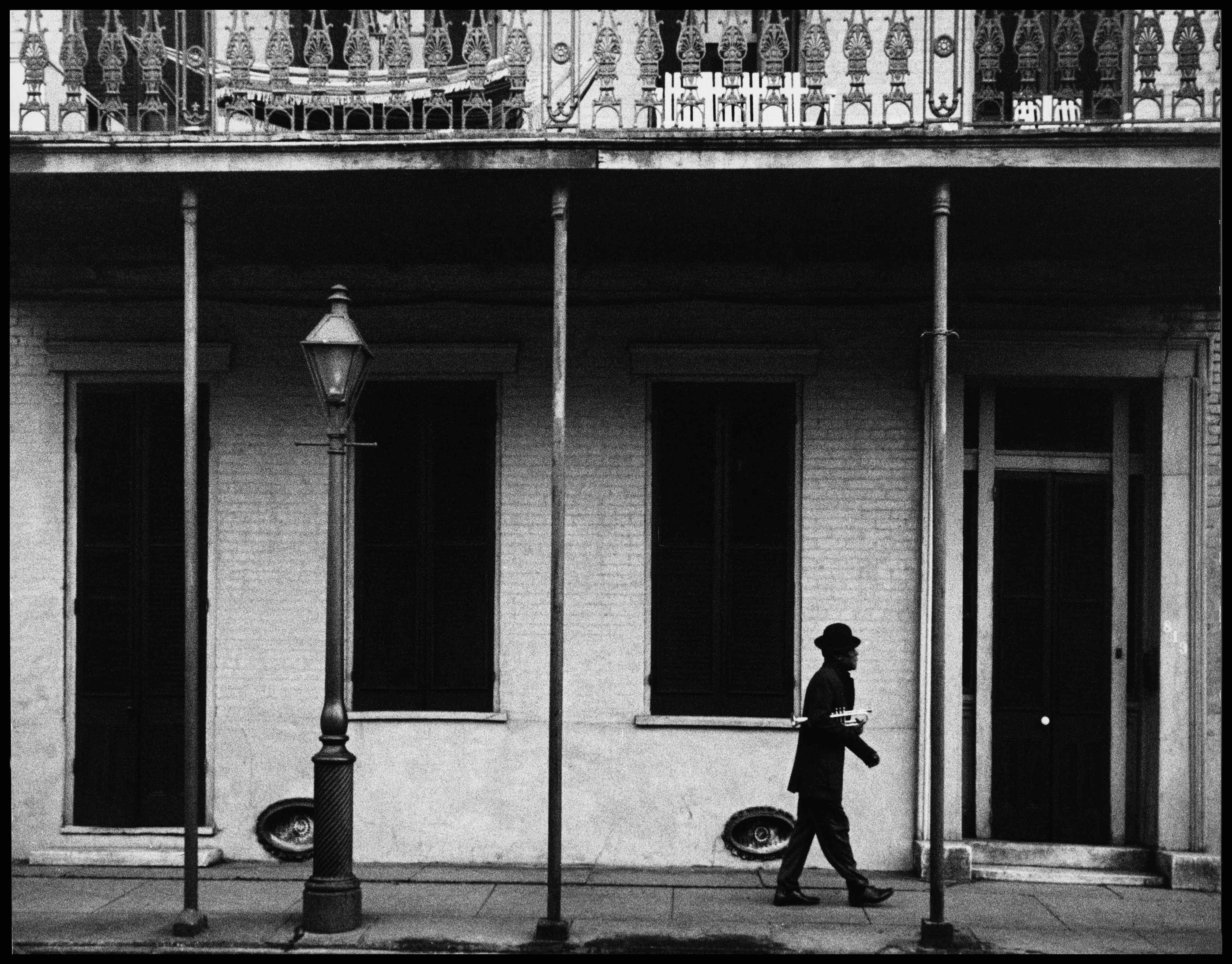 USA. New Orleans, Louisiana. 1958. Ernest MILLER nicknamed Kid Punch MILLER trumpet player and singer returning home at 6 am. © Dennis Stock / Magnum Photos