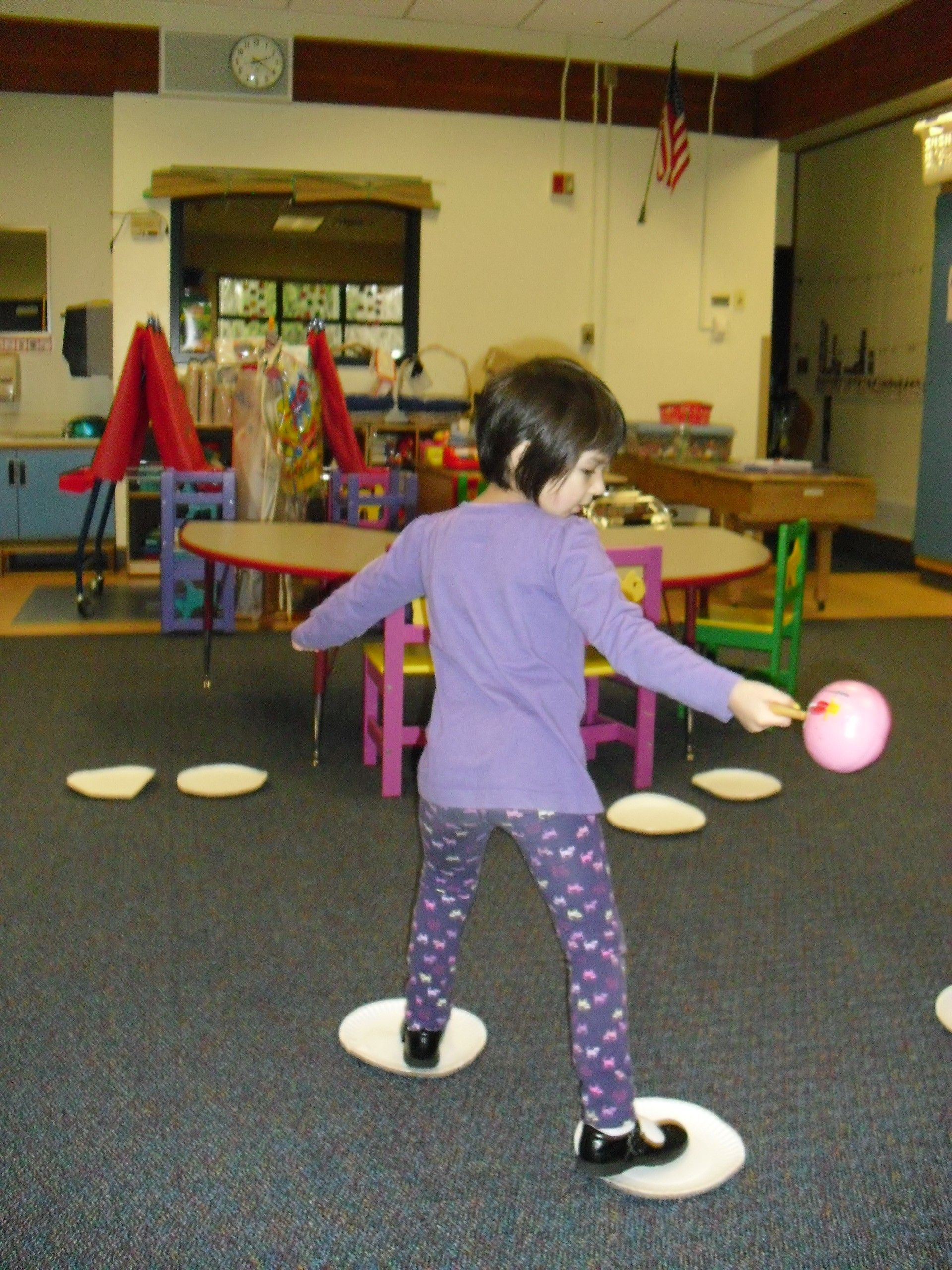 Skate around the classroom on paper plates a great for Gross motor games for preschoolers