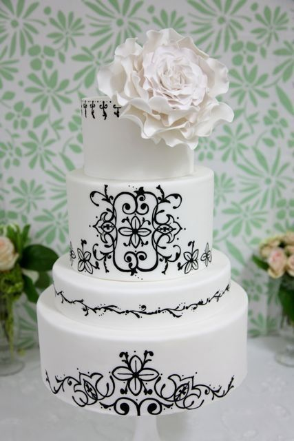 Scroll work is awesome on this wedding cake
