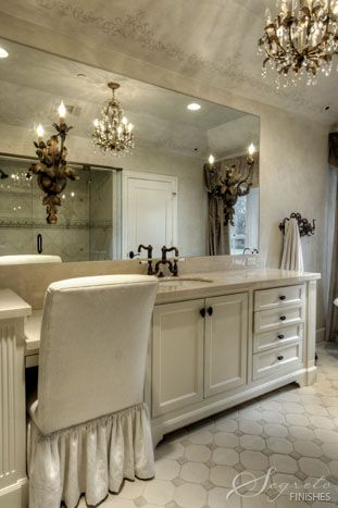 This master  bath that I did for Designer Talbot Cooley has a cove ceiling which we stenciled a soft design on creating romance.