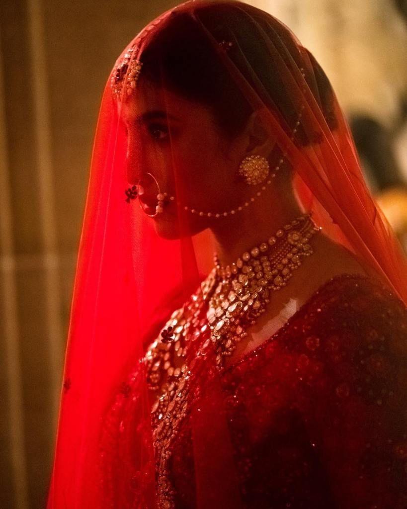 2cbca8107 Priyanka Chopra's Wedding day look in a red Sabyasachi lehenga. Click on  picture to see lehenga price. #Frugal2Fab