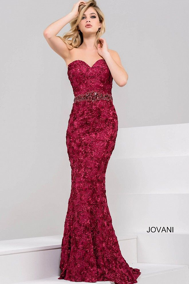 Beautiful floor length form fitting burgundy embroidered mermaid evening  gown features strapless bodice with sweetheart neckline and crystal  embellished ... ee8b04125e63