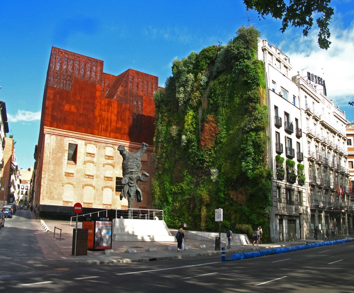 Large scale exterior vertical gardens caxia forum madrid surfaces