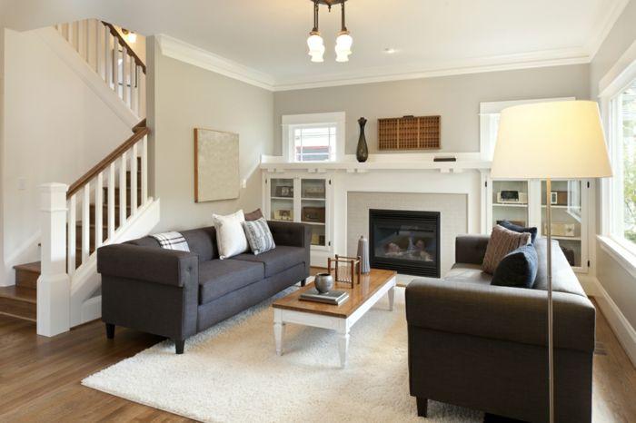 Schwarze Sofas Und Ein Kleiner Tisch, Wohnwand Selber Zusammenstellen Mit  Kamin