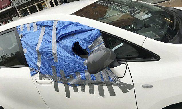 Man Spotted Driving Car With Broken Window Covered By Plastic And Tape Broken Window Window Coverings Window Repair