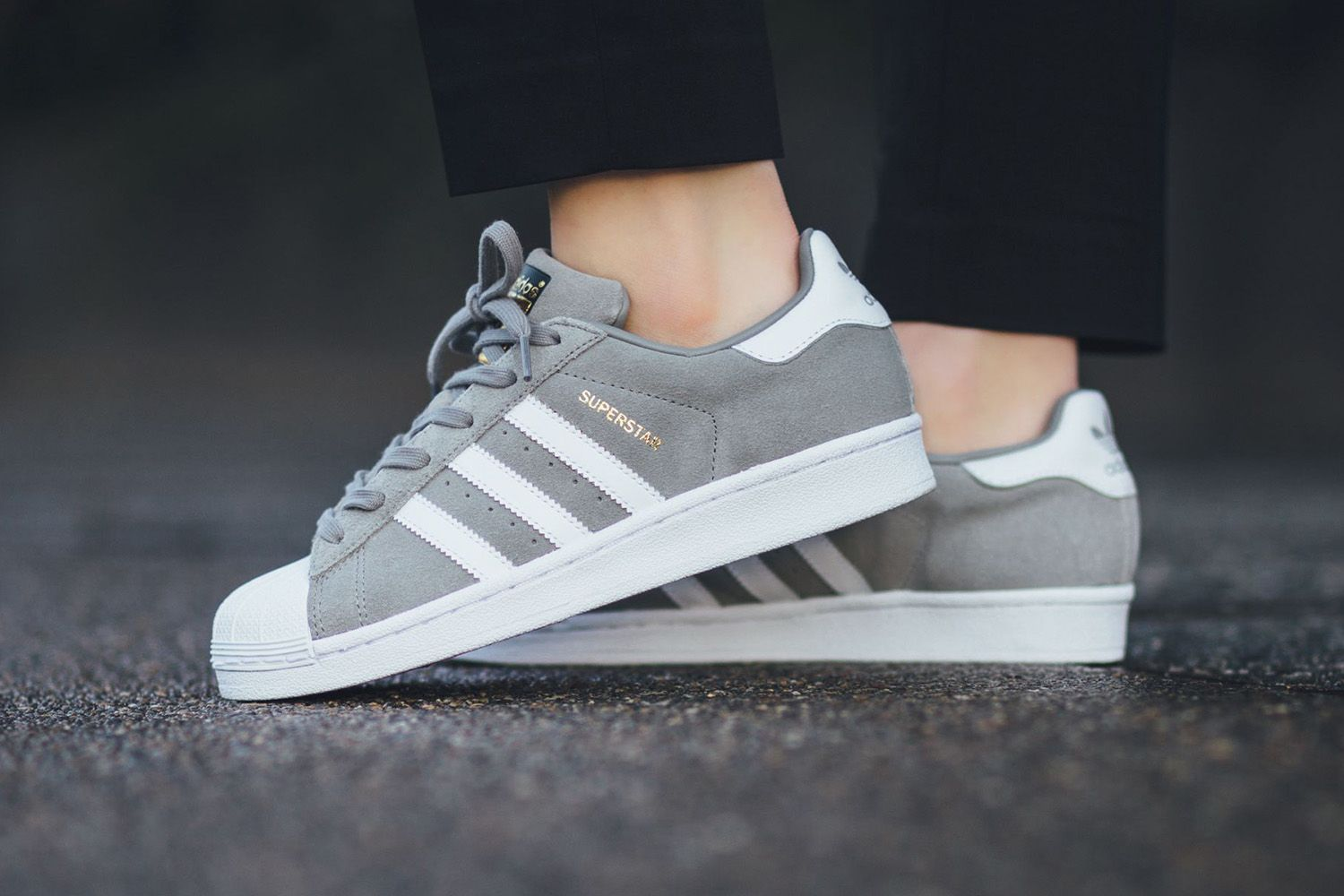A clean gray and white colorway in premium suede. Adidas