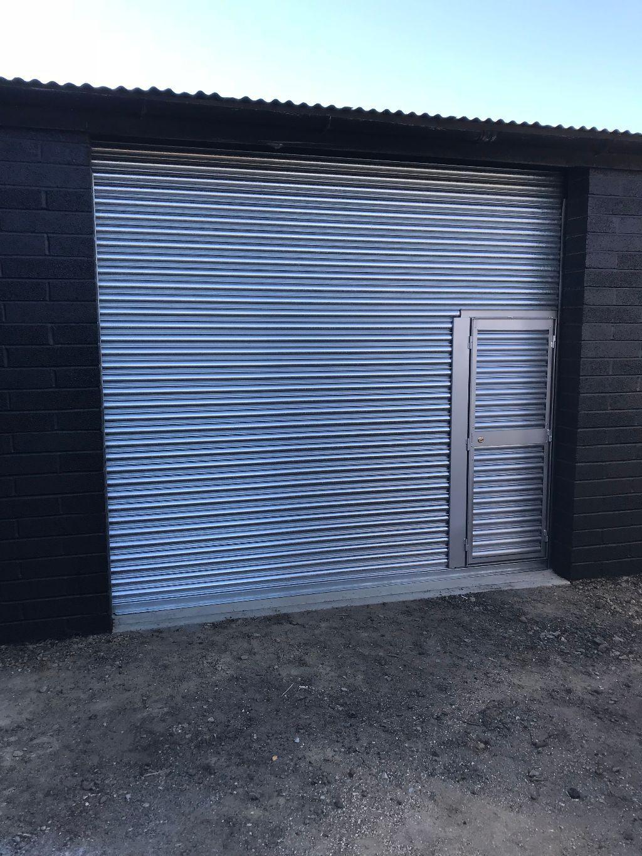 Roller shutter door with a wicket door incorporated - Installed by ...