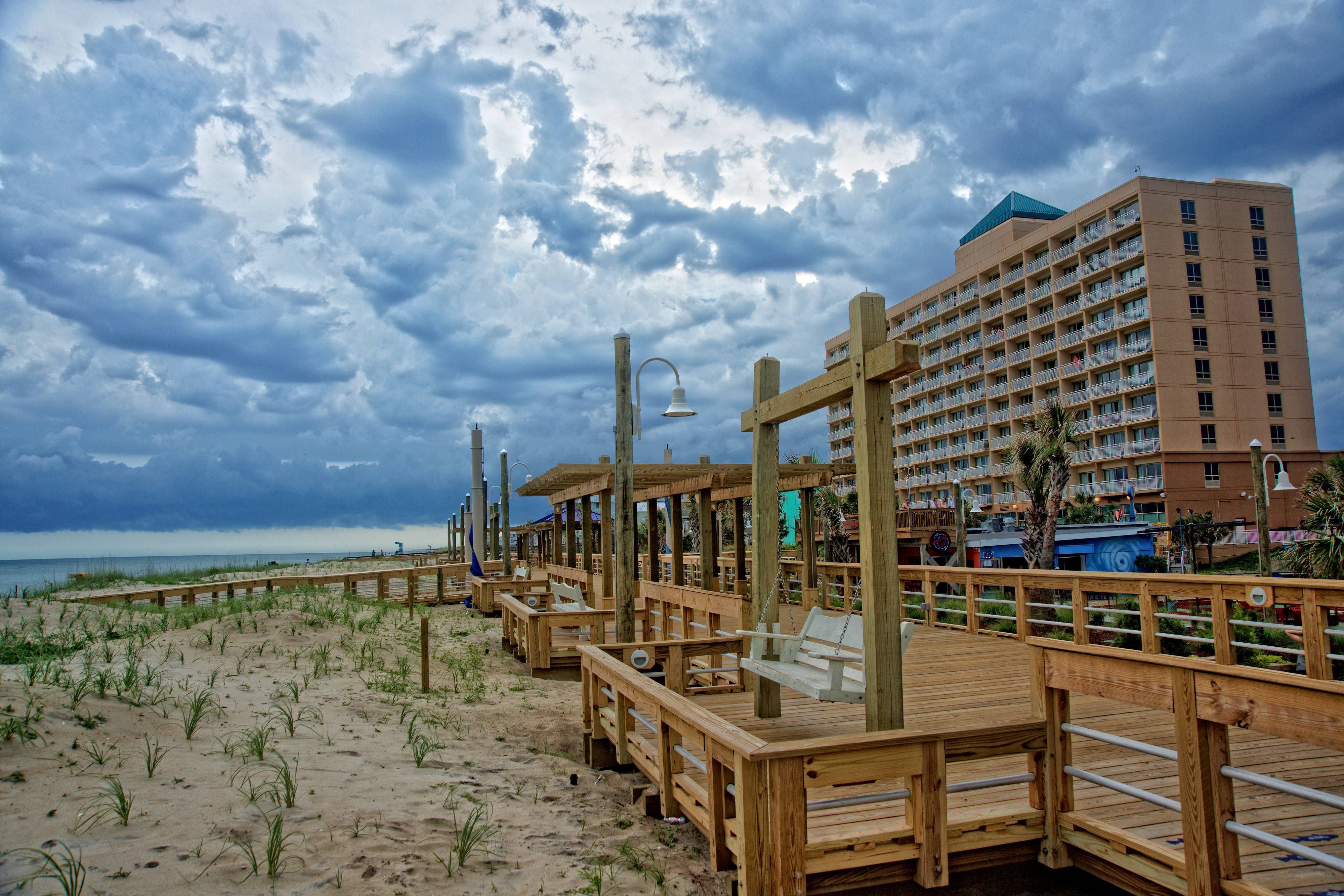 Courtyard Carolina Beach Oceanfront Exterior Boardwalk Entrance Hotels Guest Happy With Images Carolina Beach Carolina Beach Hotels Oceanfront