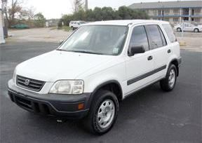 File photo of vehicle similar to the one stolen. The vehicle is a white, four-door, 1999 Honda CRV with WA license AKG-1121 and a black cargo trailer hitch.