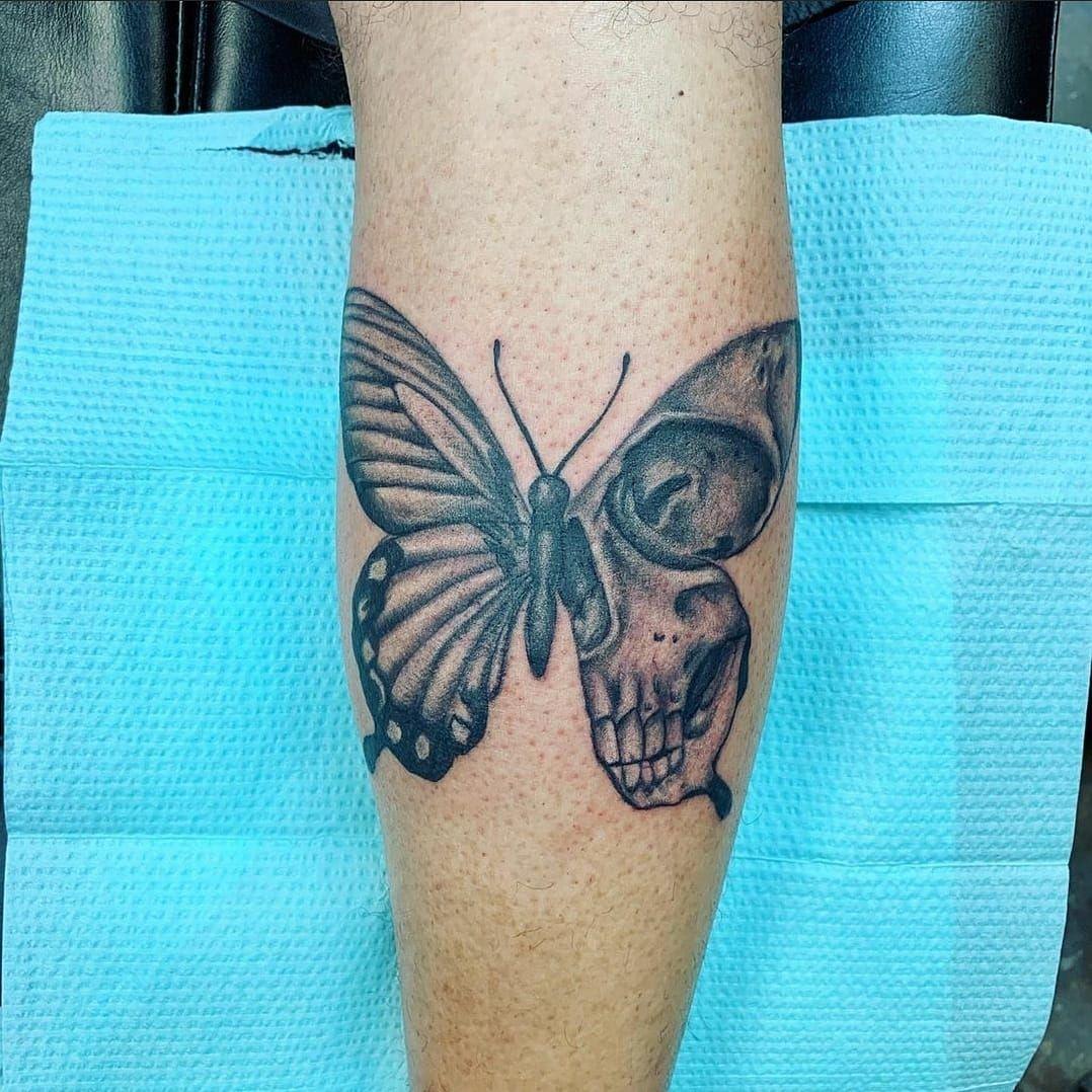 Skull tattoo black grey butterfly tattoo in 2020