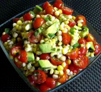 Grilled Corn, Avocado and Tomato Salad with Honey Lime Dressing. INGREDIENTS: 1 pint grape tomatoes 1 ripe avocado 2 ears of fresh sweet corn 2 tbsp fresh cilantro, chopped HONEY LIME DRESSING Juice of 1 lime 3 tbsp vegetable oil 1 tbsp honey Sea salt and fresh cracked pepper, to taste 1 clove garlic, minced Dash of cayenne pepper DIRECTIONS: Remove husks from corn and grill over medium heat for 10 minutes. The corn should have some brown spots and be tender and not mushy. Cut the corn off…