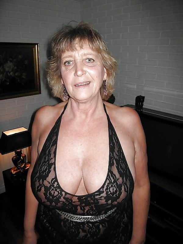 Blonde mom showing off.   Busty Mature Women