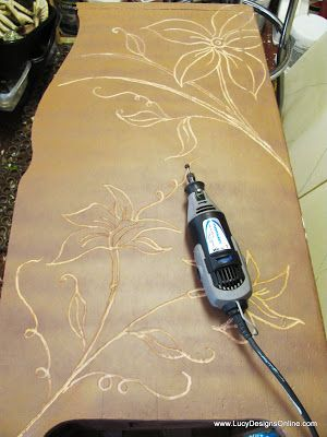 Dremel carving on furniture - drew on design and carved it out. The background just had the first basecoat  of paint at this point....
