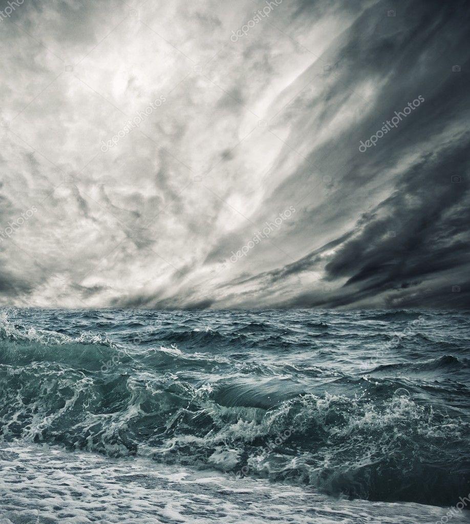 Big ocean wave breaking the shore stock photo ad
