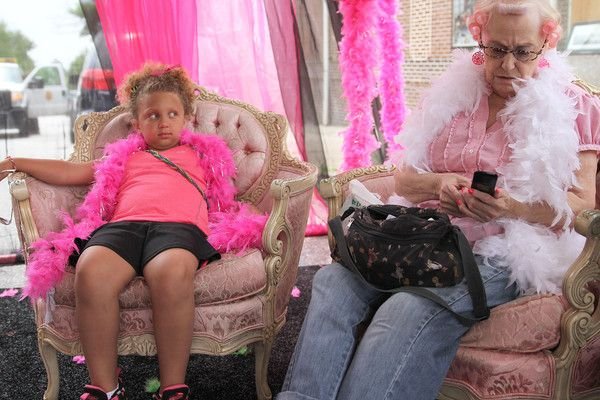 Dezarae Franz (6) watches Lola Galloway as both sit in the Glamour Tent at the 2013 Honfest in Hampden.