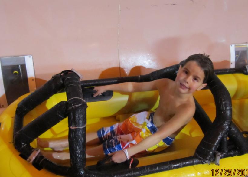 My Son Enjoying The Flyan Mayan Zip Coaster Inside Lost