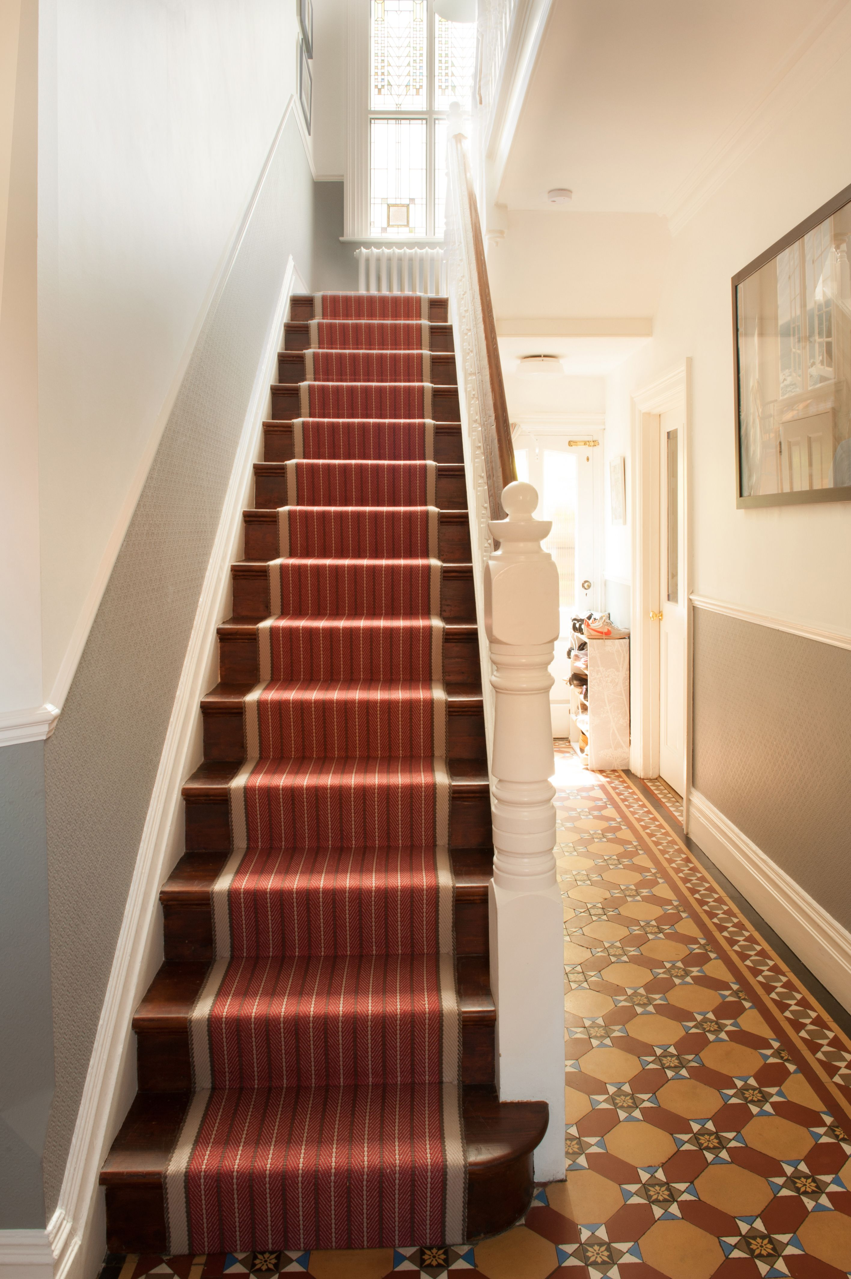 Stair Runner On Walnut Stained Floorboards