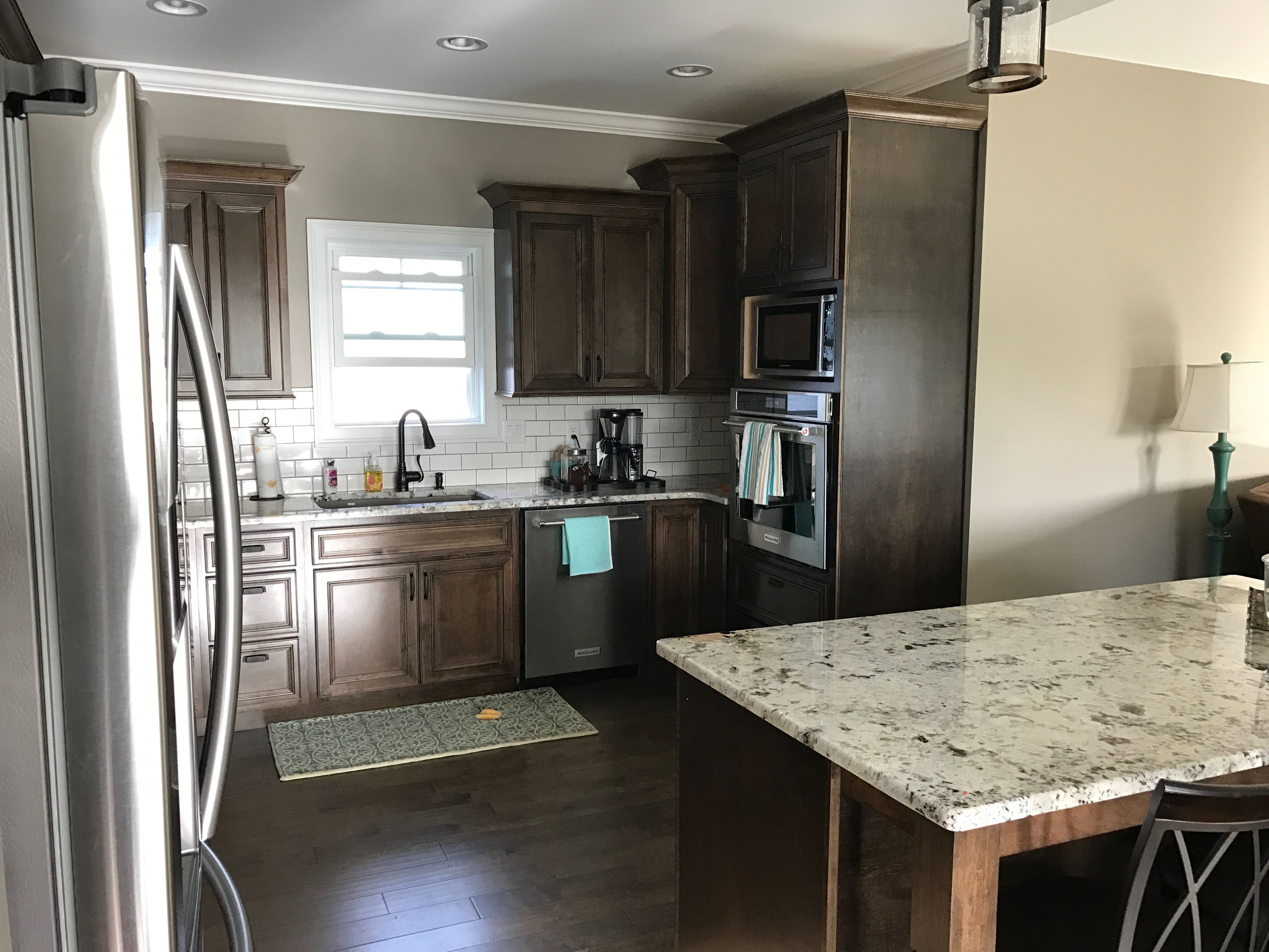 Dark Walnut Stained Cabinets Alaska White Granite White