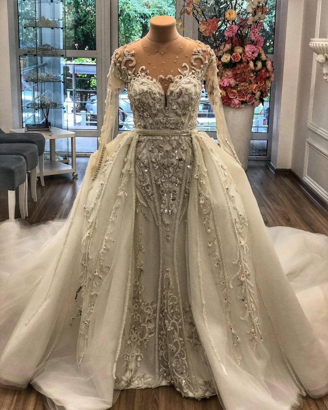 7f4460bbf2cf This beaded long sleeve wedding dress has a nice overskirt. The illusion  neckline adds to
