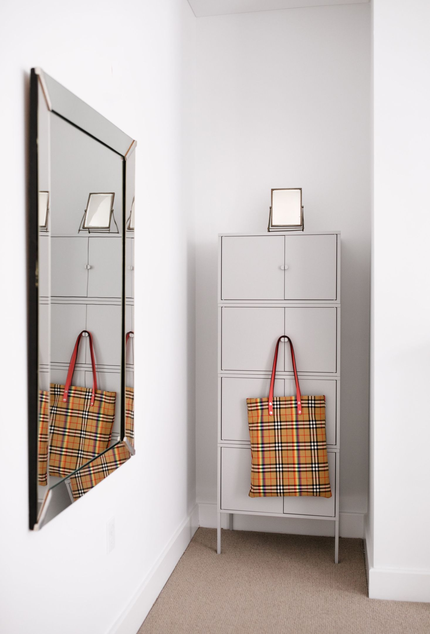 A Mesh Burberry Bag Provides A Dash Of Color Ikea Storage Unit 35 X 4 Ikea Storage Furniture Ikea Storage Units Ikea Storage