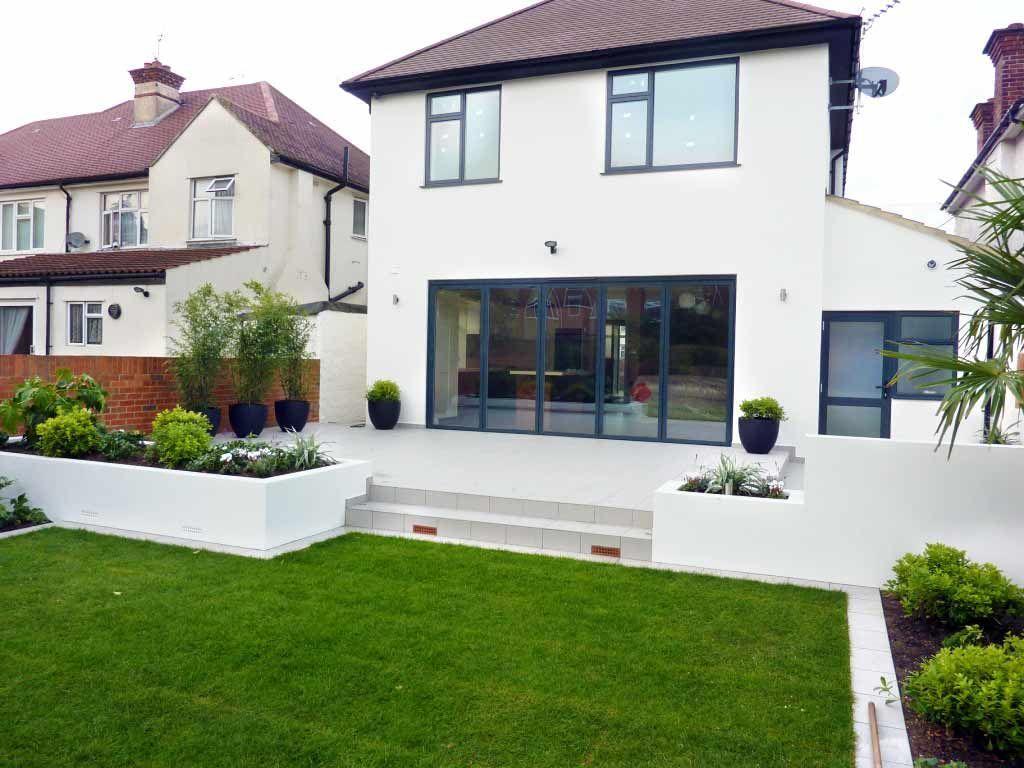 Rendered walls raised beds for house refurbishment | Backyard ...