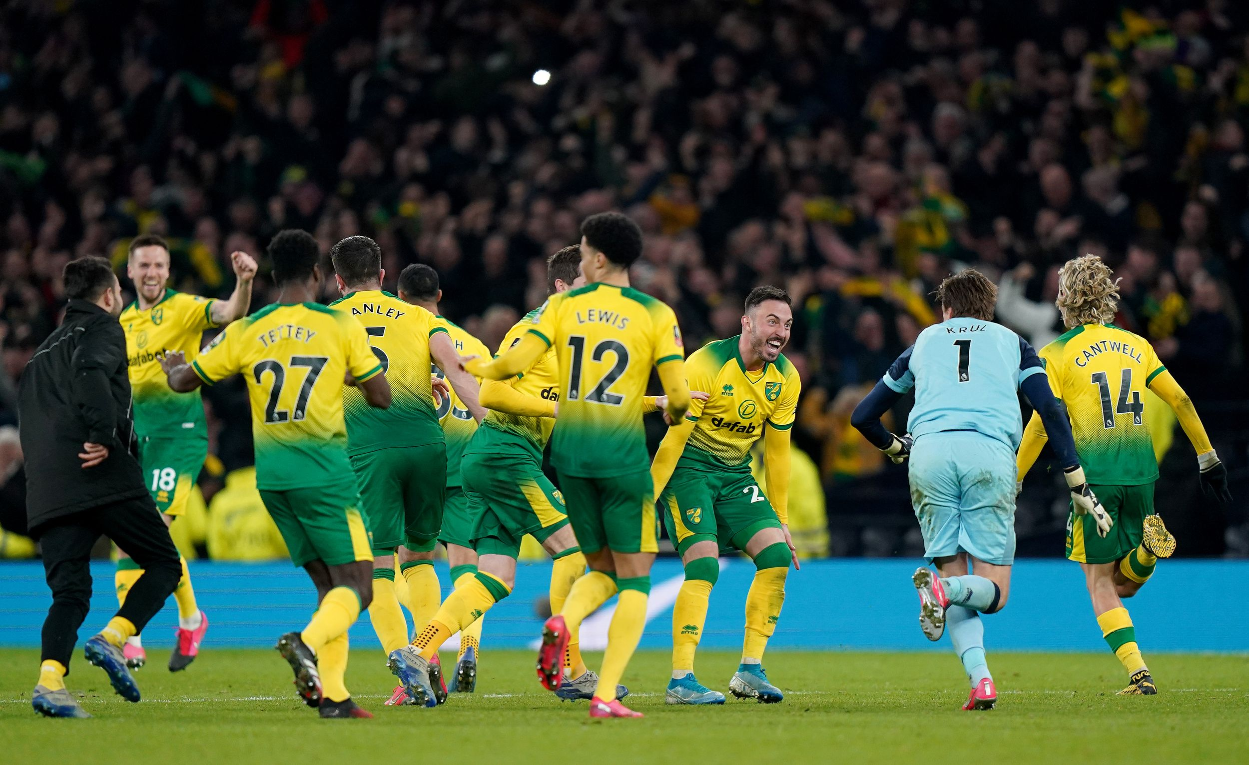 Norwich City players celebrate winning the tie in 2020