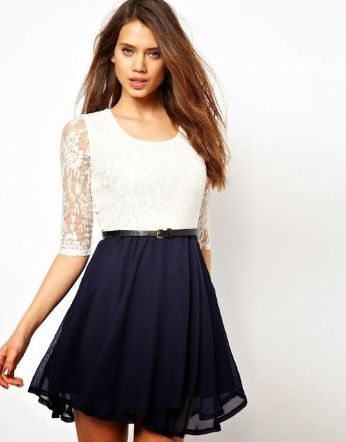 A Short Dress With Long Sleeves Top Waist Is White With A White