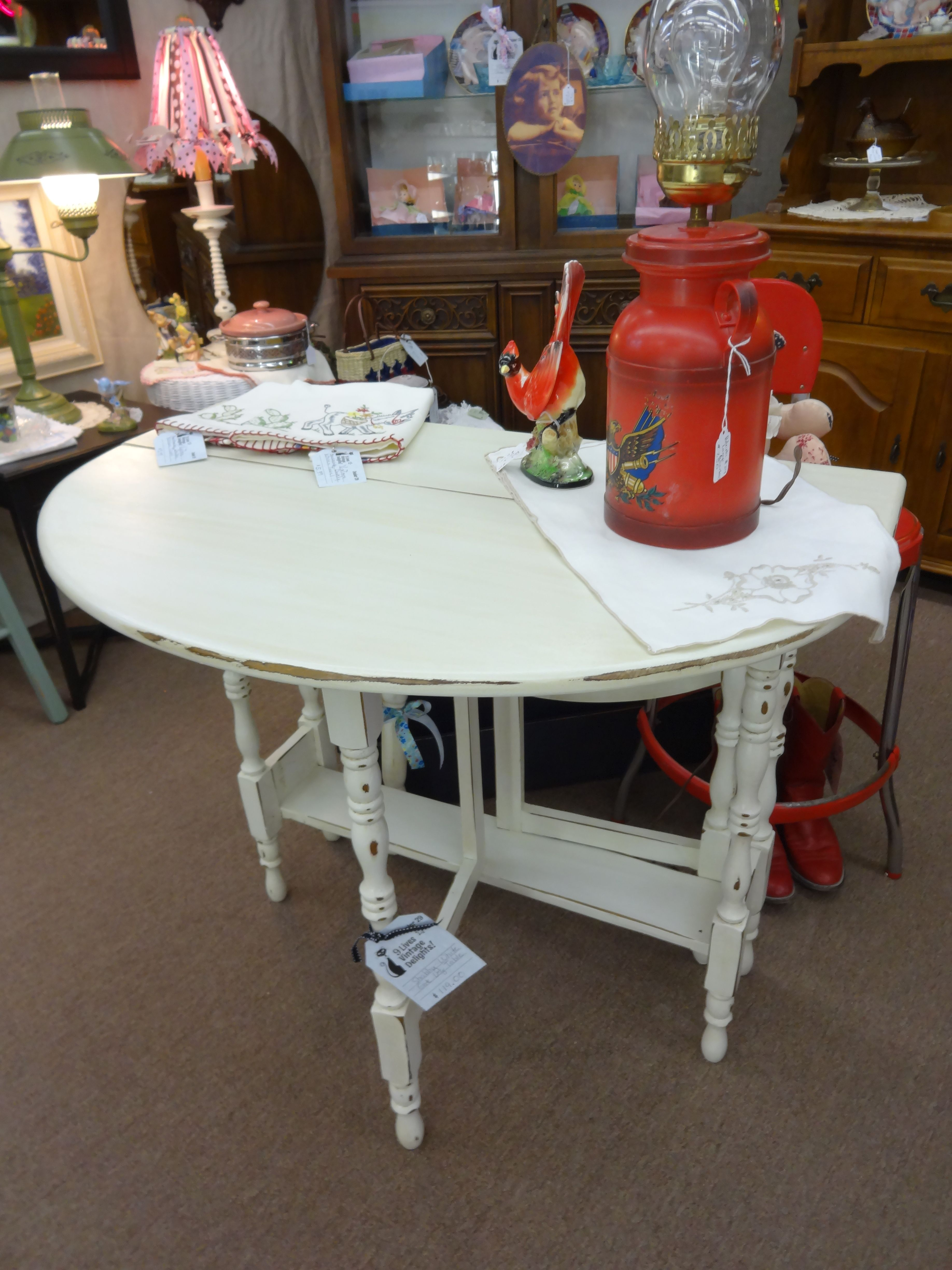 Sold this charming shabby chic gate leg table is painted creamy