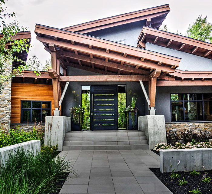 This modern mountain design blends age old timber frame for Contemporary timber frame home plans