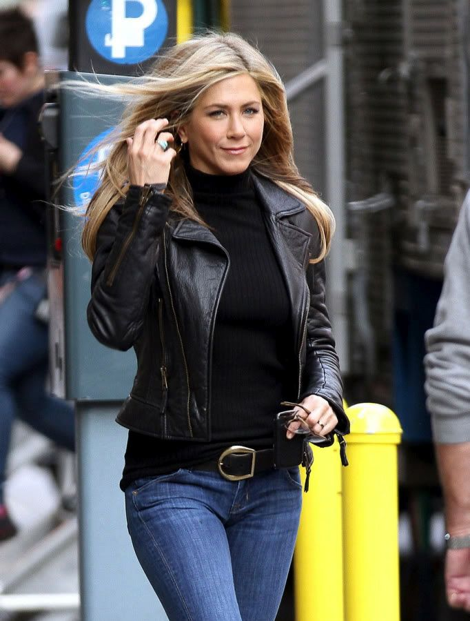 a7efc60fc219 Jennifer Aniston: Black Leather Jacket, Black Polo Neck Top And Jeans With  A Big Buckle Belt.
