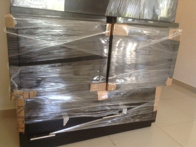 Cardboard and shrink wrap to protect furniture how to prepare your things for a move cheap - Easy to move furniture ...
