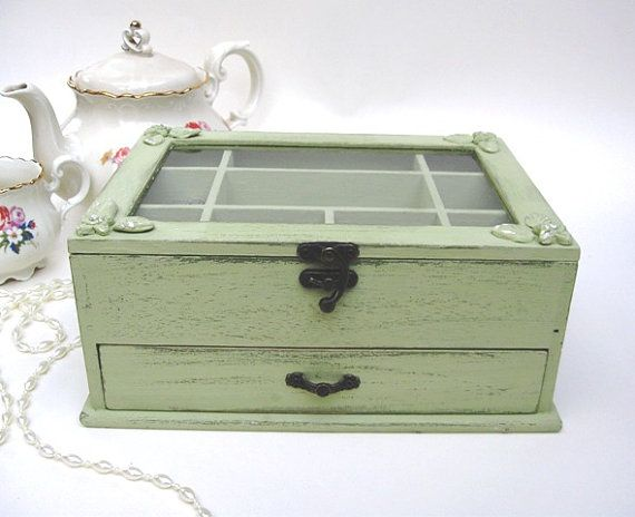 This pretty and feminine light-green jewelry box adds a romantic shabby chic charm to any room in your home . It will suit you if you have a good size collection of jewelry but it`s also nice for a girl just starting out and is a lovely gift for any occasion.  The wooden jewelry box is done in a light green waterbased acrylic paint that has been distressed to show the darker green basic coat and is painted inside in the same light green color . If you may prefer a different color I have...