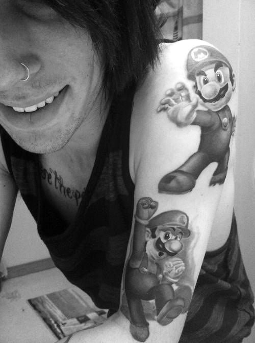 Super Mario Bros. This guy is a fan for sure. The tattoos are awesome and realistic. #tattoo #tattoos #ink #inked