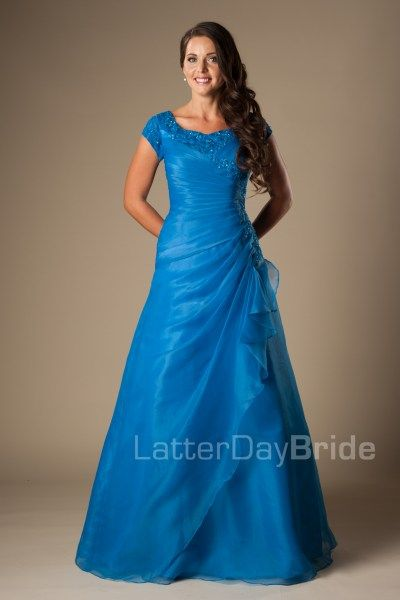 Madison   Modest Prom Dress   Mormon Prom Gown   Sleeves   LatterDayBride & Prom   SLC   Utah   Worldwide Shipping   Sweethearts Ball Gown   Senior Dinner Dance Dress   This unique modest prom dress features a flattering gather at the natural waist with cascading layers of tulle draping through the skirt, dotted with patches of floral lace.     Dress available in Purple or Blue