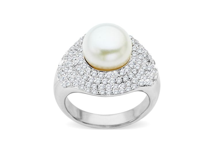 An impressive 10 mm freshwater pearl is framed by a pave of round-cut white topaz totaling 1 7/8 ct in a setting of sterling silver. Ring face measures 9/16 inches in width.
