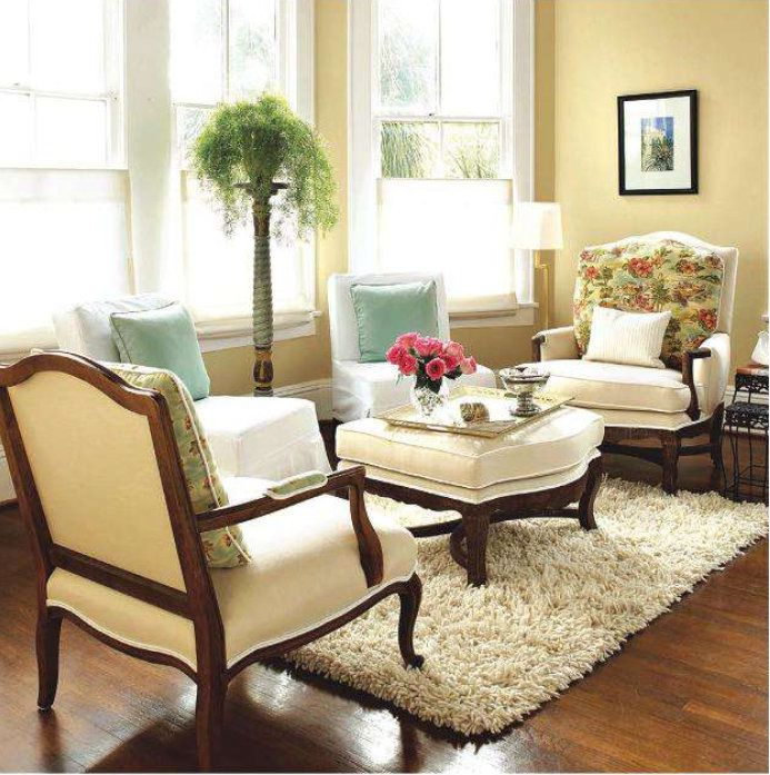 An area rug can help create an intimate feel to spaces in a home as ...