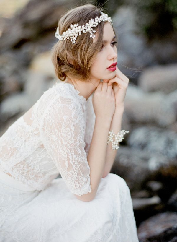 Inspired by Aia, a Greek goddess of freshwater springs, fountains, and wells, this romantic headpiece is handmade out of numerous ivory pearls wired with silver beads. It ties beautifully at the back with a double satin ribbon.