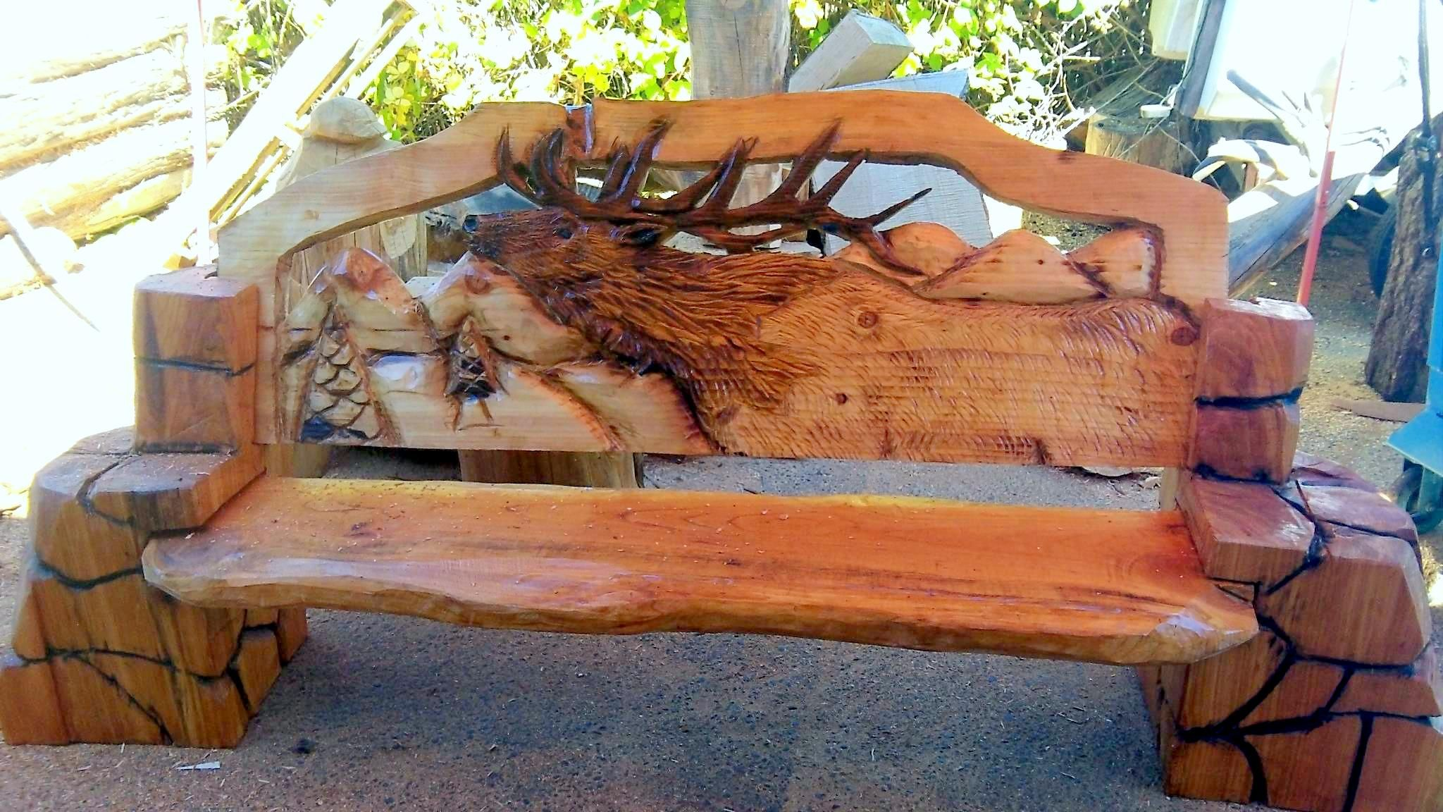 Chainsaw carved wood benches elk chainsaw carving around the