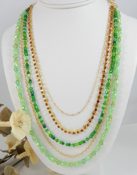 Check out this item in my Etsy shop https://www.etsy.com/listing/451385880/multi-strand-beaded-necklacegold