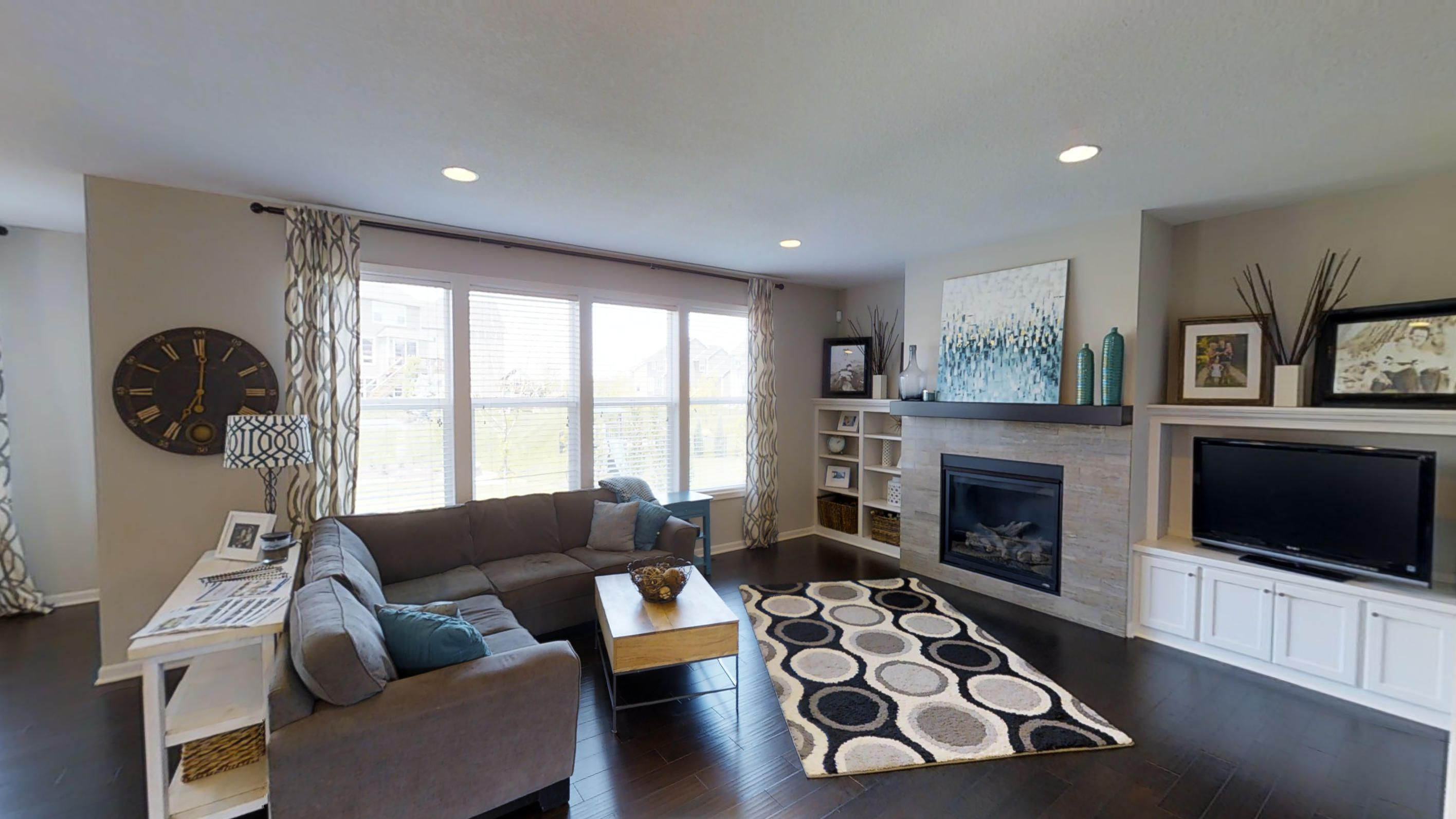 Beautiful family room has a gas fireplace and custom built