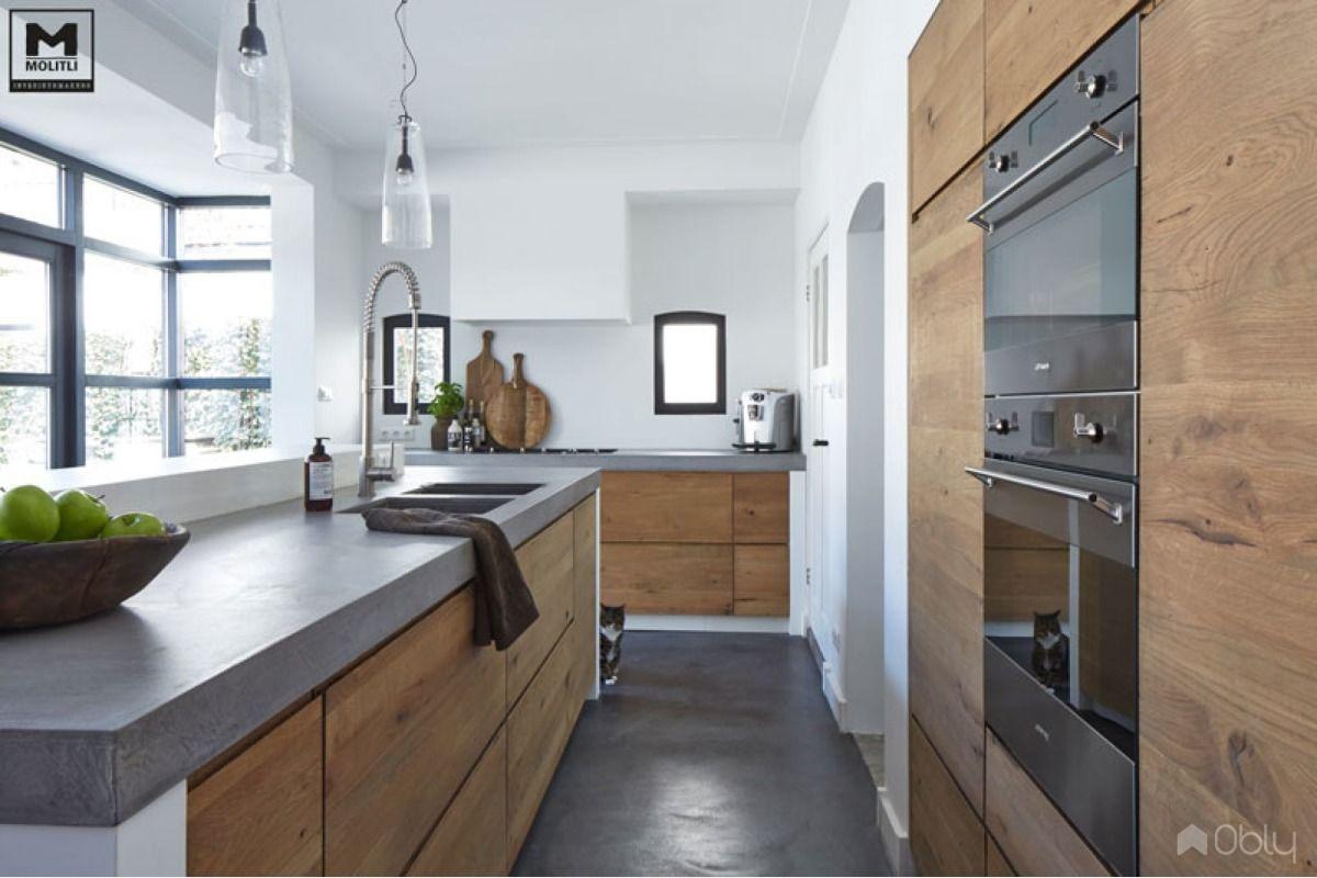 Keuken van betonstuc en hout cabinets kitchens