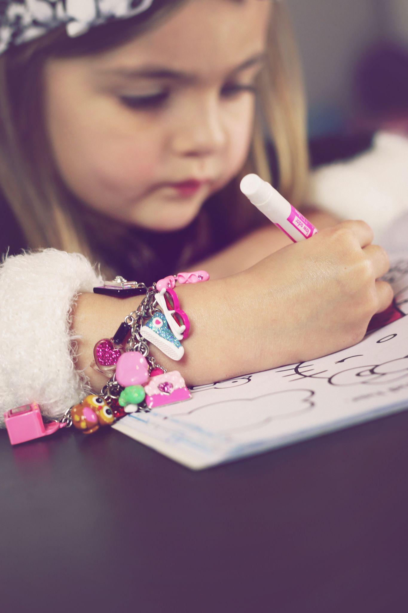 Ivy loves her new charm bracelet!! #chasinivy #charmit