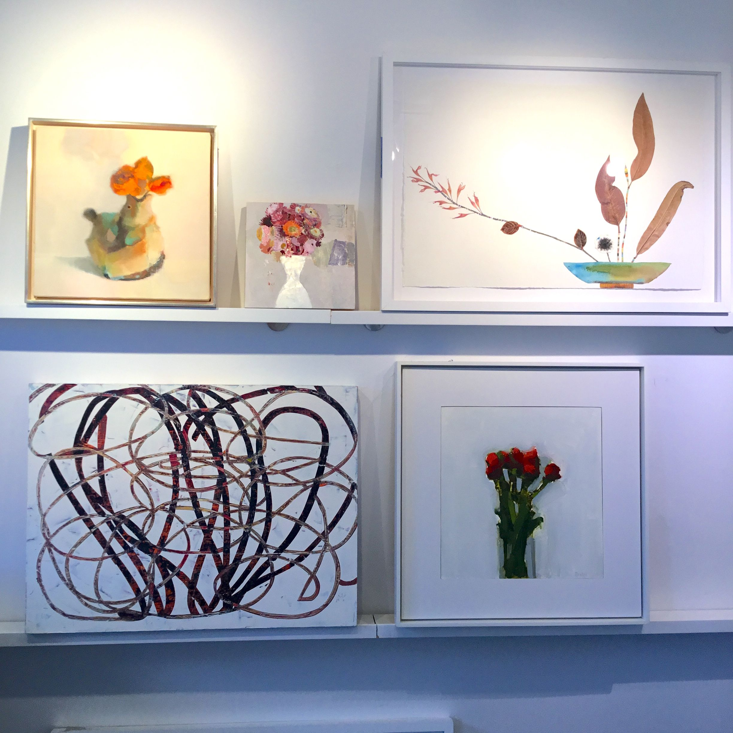 Floral paintings on the gallery wall by Stephanie London
